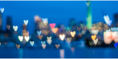 city skyline with blurred heart-shaped lights